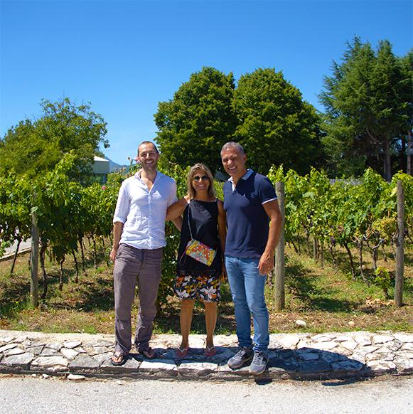Scott, Lori and Antonio in Front of Campi Valerio's vineyards